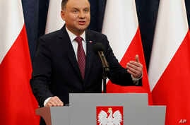 Poland's President Andrzej Duda tells a news conference he has decided to sign two laws that will put courts under more political control even though they are part of a review a concerned European Union is conducting in  Warsaw, Poland, Dec. 20, 2017