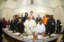 In this photo provided by Vatican newspaper L'Osservatore Romano, Pope Francis, center, and from left, Rabbi Abraham Skorka, Venerable Bhikkhuni Thich Nu Chan Khong, Her Holiness Mata Amritanandamayi and Undersecretary of State of Al Azhar Alsharif,