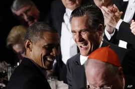 Republican presidential candidate and former Massachusetts Gov. Mitt Romney and President Barack Obama laugh as Romney gets up to address the 67th annual Alfred E. Smith Memorial Foundation Dinner, a charity gala organized by the Archdiocese of New Y