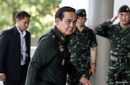 Thai Army chief General Prayuth Chan-Ocha arrives before a meeting to discuss the 2015 national budget at the Army Club in Bangkok, June 13, 2014.