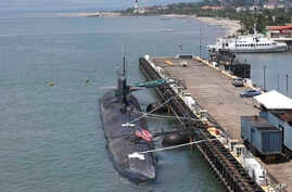 Crewmen work on the U.S. submarine USS Olympia which is docked at Subic Freeport, a former U.S. naval base, west of Manila, Philippines on a routine port call Oct. 8, 2012.