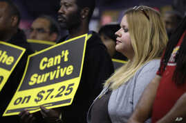 FILE - Amy Jennewein participates in a rally in support of raising the minimum wage University City, Mo.