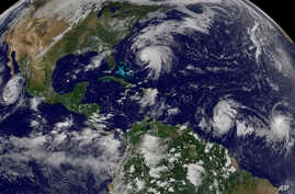This image made available by the NOAA-NASA GOES Project shows Tropical Storm Norma, far left, on the Pacific Ocean side of Mexico; Hurricane Jose, center, east of Florida; Tropical Depression 15, second from right, north of South America; and Tropica