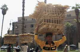 Men sell bread in front of Al-Hussein mosque, near a popular tourist area in old Cairo, Oct. 29, 2013.