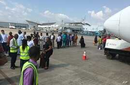 FILE - Passengers are searched before boarding a flight at the Nnamdi Azikiwe International Airport in Abuja, Nigeria, Oct. 15, 2016. Nigeria will close the airport for six weeks to repair the runway.