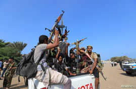 FILE - Houthi militants ride on the back of a truck in the Red Sea city of Hodeidah, Yemen, Dec. 29, 2018.