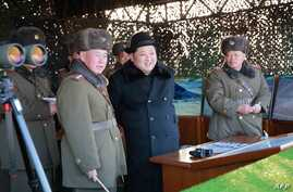 Undated photo released by North Korea's official Korean Central News Agency (KCNA) on Feb. 21, 2016 shows North Korean leader Kim Jong-Un (C) inspecting maneuvers for attack and defense between large combined units of the Korean People's Army (KPA).