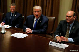President Donald Trump meets with a bipartisan group of members of Congress, including Representative Josh Gottheimer, D-N.J., at left, and Representative Tom Reed, R-N.Y., at the White House in Washington, Sept. 13, 2017.