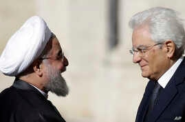 Iranian President Hassan Rouhani (l) meets Italian President Sergio Mattarella, upon his arrival at the Quirinale Presidential palace, in Rome, Jan. 25, 2016.