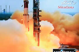 This television frame grab taken from Indian television channel NDTV, broadcasting live footage from state television Doordarshan, shows the PSLV-C25 launch vehicle carrying the Mars Orbiter probe as its payload lifting off from the launch pad in Sri