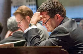 FILE - State Sen. Mark Green, R-Clarksville, sits at his desk in the Senate chamber in Nashville, Tenn., April 17, 2013.