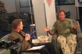 Then American Forces Network reporter Kane Farabaugh interviews Robin Williams in Afghanistan in 2002.