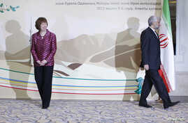 Iran's Chief Negotiator Saeed Jalili (R) and European Union Foreign Policy Chief Catherine Ashton walk away after posing for a photograph before talks in Almaty, April 5, 2013.