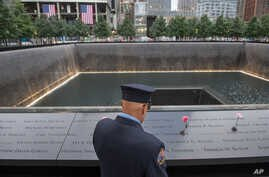 Retired New York City firefighter Joseph McCormick visits the South Pool prior to a ceremony at the World Trade Center site in New York on Sept. 11, 2015.