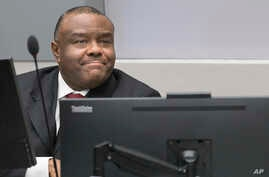 FILE - Jean-Pierre Bemba takes his seat in the court room of the International Criminal Court in The Hague, Netherlands, March 21, 2016.