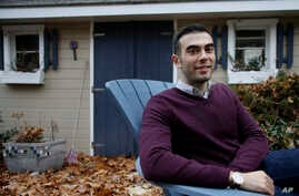 Joshua Pickar, of Lexington, Mass., one of 32 new Rhodes scholars from the U.S., sits for a photograph, Nov. 20, 2016, in Lexington.