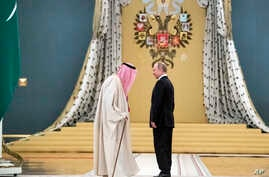 Russian President Vladimir Putin, right, talks with Saudi King Salman during their meeting in the Kremlin, Moscow, Russia, Thursday, Oct. 5, 2017.