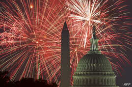 Fireworks explode over the National Mall as the US Capitol (R) and National Monument are seen on July 4, 2017, in Washington, DC.