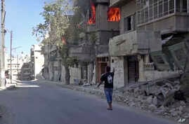 This handout frame grab from video provided by Doctors Without Borders, shows a house on fire in Aleppo, Syria, Oct. 5, 2016.