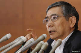 Bank of Japan Governor Haruhiko Kuroda speaks during a news conference in Tokyo. He stressed that the Japanese government must keep up efforts to restore the country's fiscal health, August 8, 2013.