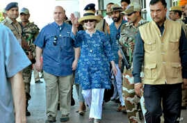Former U.S. Secretary of State Hillary Clinton, center, waves as she comes out of the Jodhpur airport upoon her arrival in Jodhpur, Rajasthan state, India, March 13, 2018.