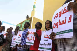 FILE - Sudanese journalists protest against a proposed new press law they say would tighten restrictions on media freedom, at the headquarters of the National Council for Press and Publications, in Sudan's capital Khartoum, Nov. 15, 2017.