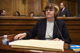 Rachel Mitchell, a prosecutor from Arizona, selected to question Supreme Court nominee Brett Kavanaugh and Christine Blasey Ford, the woman accusing Kavanaugh of sexually assaulting her at a party in the early 1980s, is seen before the U.S. Senate Ju