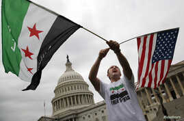 Jehad Sibai, a physician from Michigan, with a group of Syrian-Americans, rallies at U.S. Capitol, Washington, Sept. 9, 2013.