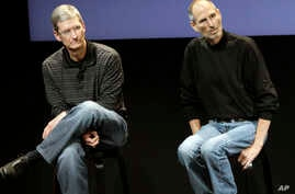 FILE - This July 16, 2010, photo shows Apple's Tim Cook, left, and Steve Jobs, right, during a meeting at Apple in Cupertino, California. Apple wants to encourage millions of iPhone owners to register as organ donors through a new software update.