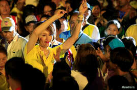 "FILE - Geraldine Roman, a transgender congressional candidate, gestures at the crowd during a ""Miting de Avance"" (last political campaign rally) for the national election in Orani town, Bataan province, north of Manila, May 6, 2016."