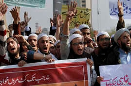 FILE - Pakistani students of Islamic seminaries chant slogans during a rally in support of blasphemy laws, in Islamabad, Pakistan, March 8, 2017.