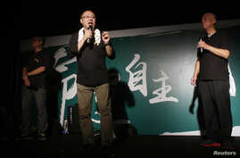 FILE - (L-R) Founders of the Occupy Central civil disobedience movement, academic Chan Kin-man, academic Benny Tai and Reverend Chu Yiu-ming, attend a rally, attended by thousands, in front of the government headquarters in Hong Kong, Sept.  27, 2014
