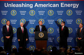 U.S. President Donald Trump participates in a discussion on energy with Energy Secretary Rick Perry (2nd-R), EPA Administrator Scott Pruitt (R), Interior Secretary Ryan Zinke (L) and Vice President Mike Pence (2nd-L), at the Department of Energy in W