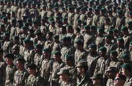 New members of the Afghan National Army attend their graduation ceremony at the Afghan Military Academy in Kabul, Afghanistan, Nov. 23, 2014.