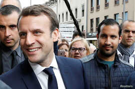 Emmanuel Macron, left, is campaigns for the 2017 presidential election, flanked by Alexandre Benalla, right, head of security, in Rodez, France, May 5, 2017.
