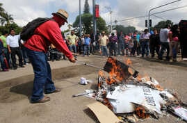Protesters burn ballot boxes and ballots in the city of Oaxaca, Mexico, June 7, 2015.