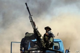 Libyan Rebels Retreat from Oil Port Under Fire from Pro-Gadhafi Forces