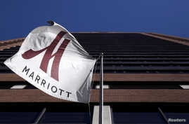 FILE - A Marriott flag hangs at the entrance of the New York Marriott Downtown hotel in Manhattan, New York.
