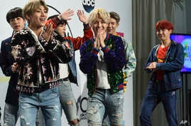 BTS poses in the press room at the American Music Awards at the Microsoft Theater on Sunday, Nov. 19, 2017, in Los Angeles.
