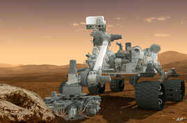 FILE -  Curiosity rover on the surface of Mars, Dec. 4, 2012.