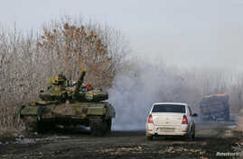 A pro-Russian separatists tank is seen on a road near the village of Rozsypne, eastern Ukraine, Dec. 15, 2014.