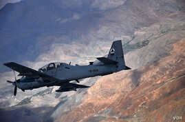 An Afghan air force A-29 Super Tucano aircraft flies over Afghanistan during a training mission, April 6, 2016.