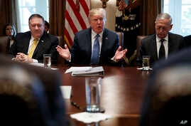 Secretary of State Mike Pompeo, left, and Secretary of Defense Jim Mattis, right, listen as President Donald Trump speaks during a Cabinet meeting at the White House, June 21, 2018, in Washington.