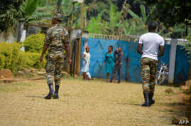 FILE - Soldiers patrol in Bafut, in the northwest English-speaking region of Cameroon, Nov. 15, 2017.