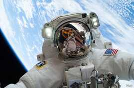 On Dec. 24, 2013, NASA astronaut Mike Hopkins, Expedition 38 Flight Engineer, participates in the second of two spacewalks, spread over a four-day period, which were designed to allow the crew to change out a faulty water pump on the exterior of the