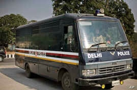 A Delhi police van carrying the accused in a gang rape of a 23-year-old woman enters a district court in New Delhi, India, January 24, 2013.