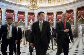 Speaker of the House Paul Ryan, R-Wis., center, and Majority Leader Kevin McCarthy, R-Calif., right, walk to the chamber where the House voted overwhelmingly to send a $15.3 billion disaster aid package to President Donald Trump, overcoming conservat...