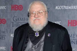 """FILE - George R. R. Martin, pictured in 2014 at HBO's """"Game of Thrones"""" fourth-season premiere in New York, writes in his blog that the sixth novel in the series is """"not done. ... I tried, I promise you. I failed.''"""
