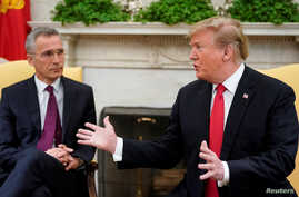 U.S. President Donald Trump speaks while meeting with NATO Secretary General Jens Stoltenberg in the Oval Office at the White House in Washington, April 2, 2019.