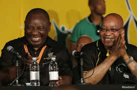 FILE: South Africa's President Jacob Zuma, right, jokes with his deputy, Cyril Ramaphosa, after Zuma's re-election in 2012. The ruling African National Party has delayed an inquiry into Zuma's spending.